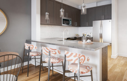 gourmet kitchen with stainless steel appliances, bar seating and pendant lighting - Dive Into Pure Comfort